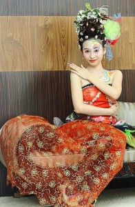 Model Goh Shia Ling wearing of a hairdo to match a dress from designer Zi Wen Chuah during an event to announce the International Beauty Expo in May